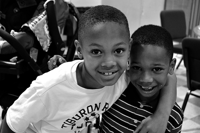 two young boys smiling at the camera
