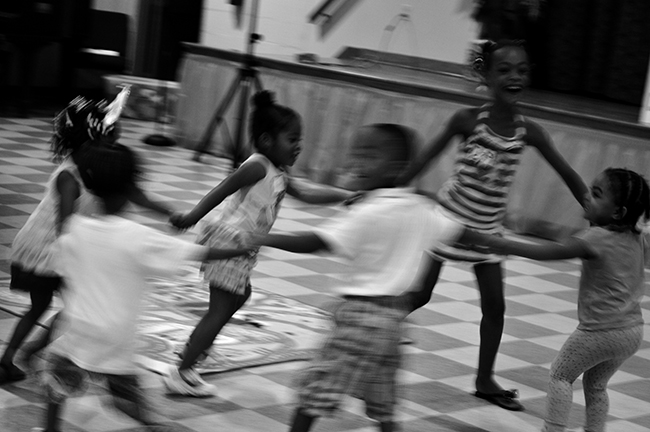 Motion shot of kids playing ring around the rosie