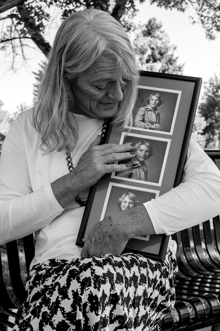 Sarah Marie gets emotional as she holds up photos of her beloved wife, Tracy, who died of Lupus during Sarah Marie's gender transition.  (Photo by Jessica Studnick)