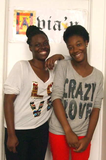 "Photo of D'Ann and Avian wearing T-shirts with the words ""love"" and ""Crazy Love."""
