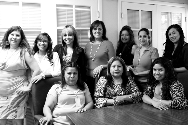 portrait of 10 women who work at the shelter for battered women, many of them former clients